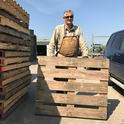 Gerry from Logs and Kindling picking up some pallets from our yard